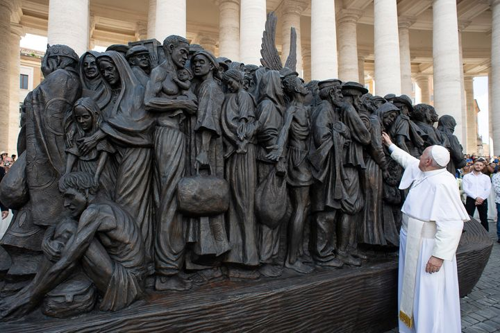 Pope Francis attends the unveiling Sunday of the sculpture commemorating migrants and refugees by Canadian artist Timothy Sch