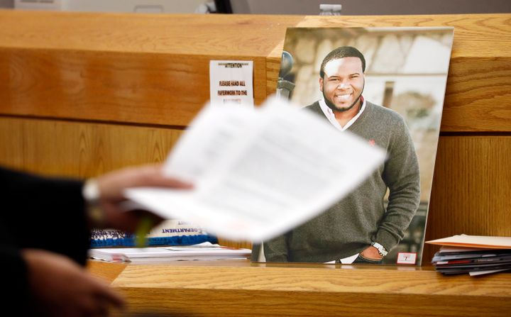 A photo of Botham Jean leans against Judge Tammy Kemp's bench during the murder trial of former Dallas police officer Amber G