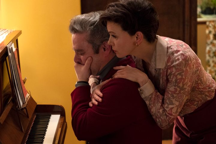 "In ""Judy,""Judy Garland (Renée Zellweger) is shown comforting a gay devotee, Dan (Andy Nyman)."