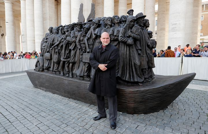 Sculptor Timothy P. Schmalz with his statue Sunday at the Vatican.