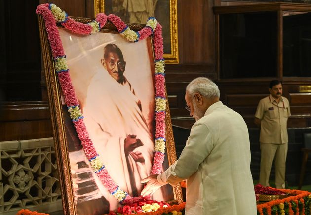 Prime Minister Narendra Modi pays tribute to Mahatma Gandhi at Parliament House in New Delhi on
