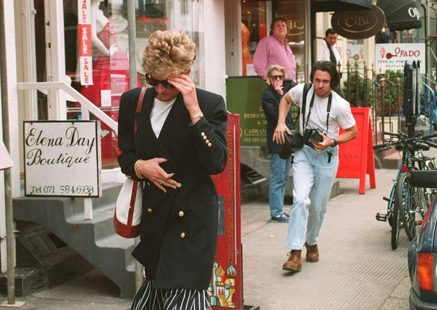 Princess Diana trying to avoid a photographer in