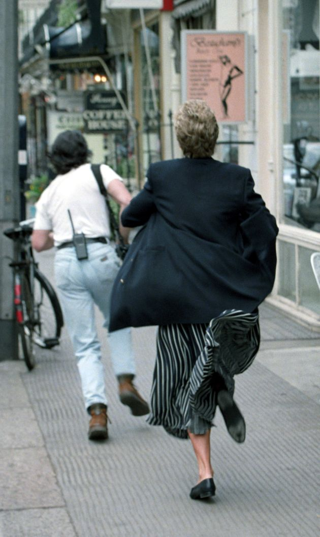Princess Diana appearing to run after a member of the paparazzi who was bothering
