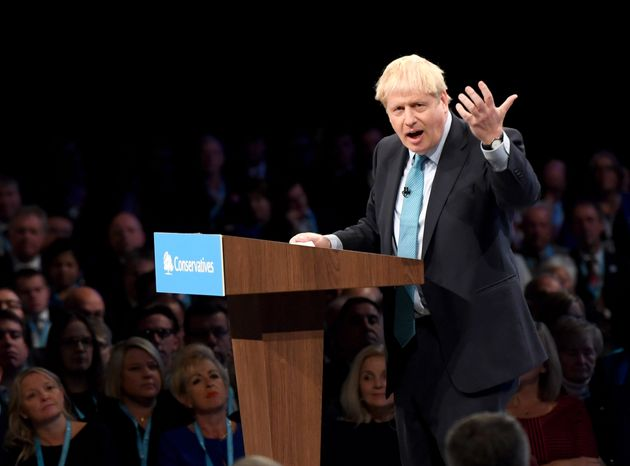 Prime Minister Boris Johnson delivers his speech during the Conservative party conference at the Manchester...