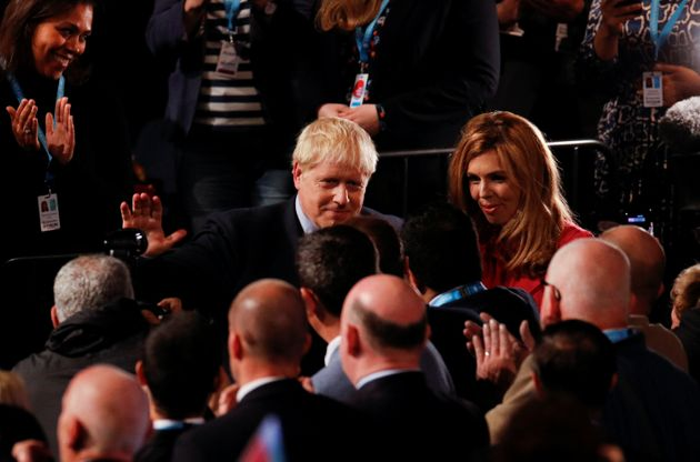 Johnson greets supporters, next to his partner Carrie Symonds, after his closing