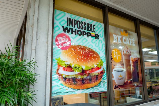 A Burger King in the San Francisco Bay Area advertising the Impossible Whopper, a meat-free burger made...