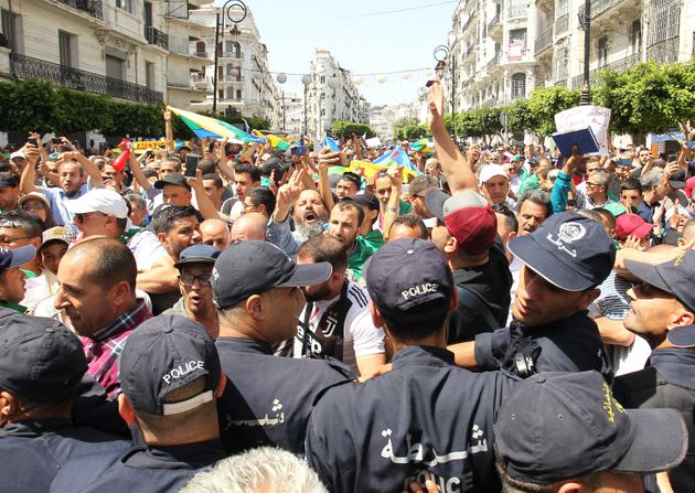 Algerian protesters face a cordon of police during the weekly Friday demonstration in the capital Algiers...