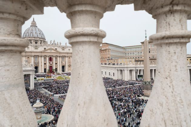 Faithful gather to follow Pope Francis celebrating Easter Mass in St. Peter's Square at the Vatican,...