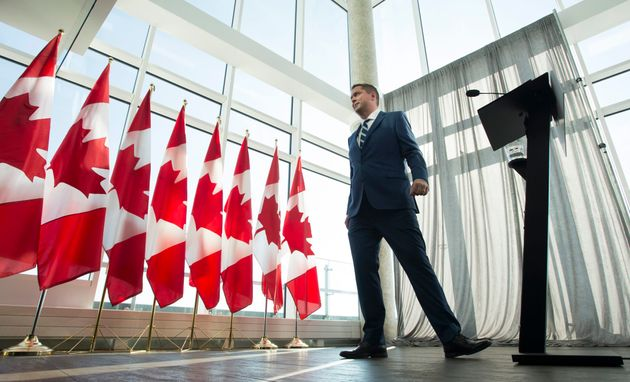 Conservative leader Andrew Scheer is seen leaving following a morning announcement in Toronto, Tuesday,...