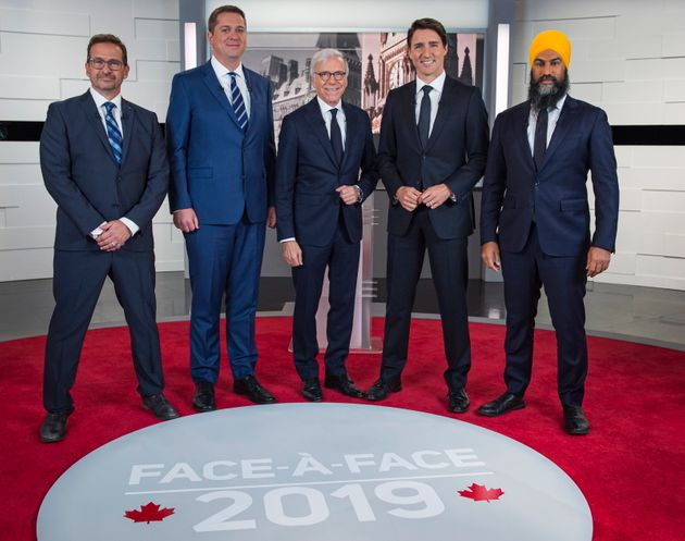 The federal leaders pose for a photo at the TVA french debate with host Pierre Bruneau for the 2019 federal...