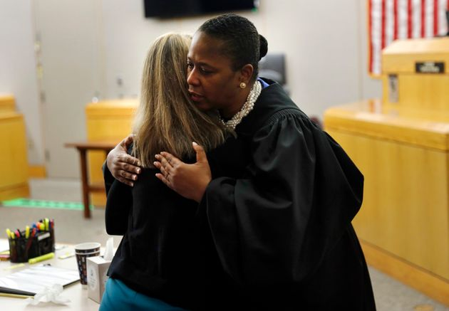 Amber Guyger: Brother Embraces Ex-Police Officer Who Shot Botham Jean And Says 'I Forgive