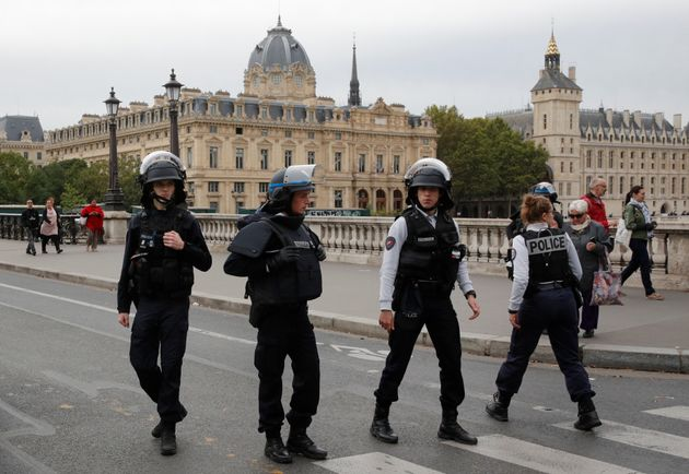 French police secure the area in front of the Paris Police headquarters in