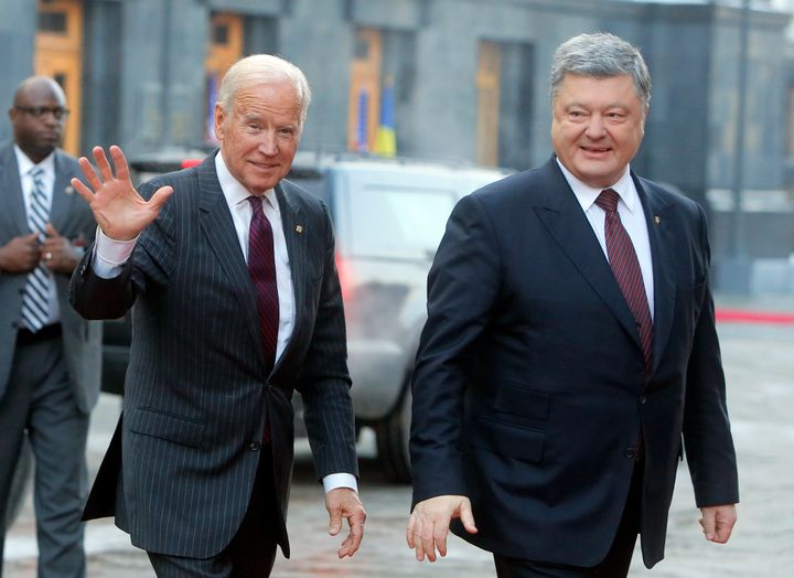Then-Vice President Joe Biden, left, and Ukraine's then-President Petro Poroshenko smile at the media during a meeting in Kie
