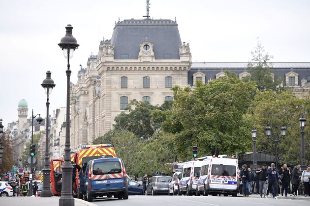 Police vehicles are parked near Paris prefecture de police (police headquarters) after three persons...