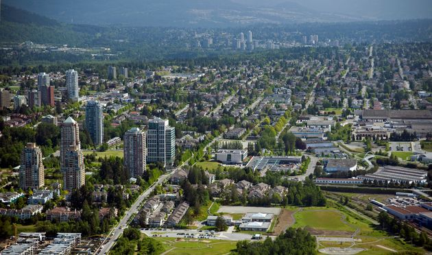 An aerial view of Burnaby, B.C., in the Greater Vancouver area, with New Westminster in the