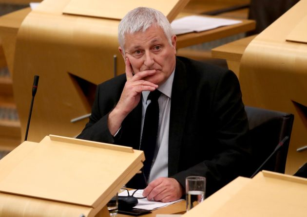 Scottish Green Party's John Finnie in the main chamber of the Scottish Parliament in