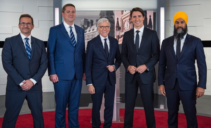 Leader of the Bloc Quebecois Yves-Francois Blanchet, left to right, Conservative Leader Andrew Scheer, TVA host Pierre Bruneau, Liberal Leader Justin Trudeau and NDP Leader Jagmeet Singh pose for a photo at the TVA french debate for the 2019 federal election, in Montreal on Oct. 2, 2019.