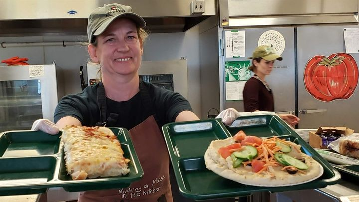 Portland, Maine, school cafeteria worker Alison Mason shows off lunch options at East End Community School, including traditi