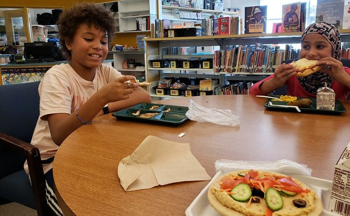 Amari Brent, left, and Rahaf Hlail, both fifth-graders at East End Community School in Portland, Maine, check out the vegan p