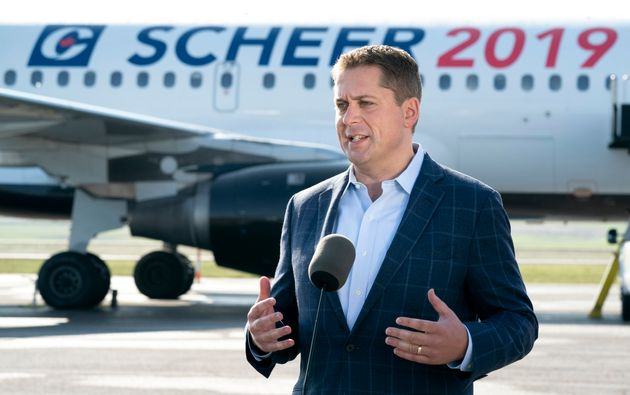 Conservative Leader Andrew Scheer responds to questions prior to boarding his campaign plane in Ottawa...