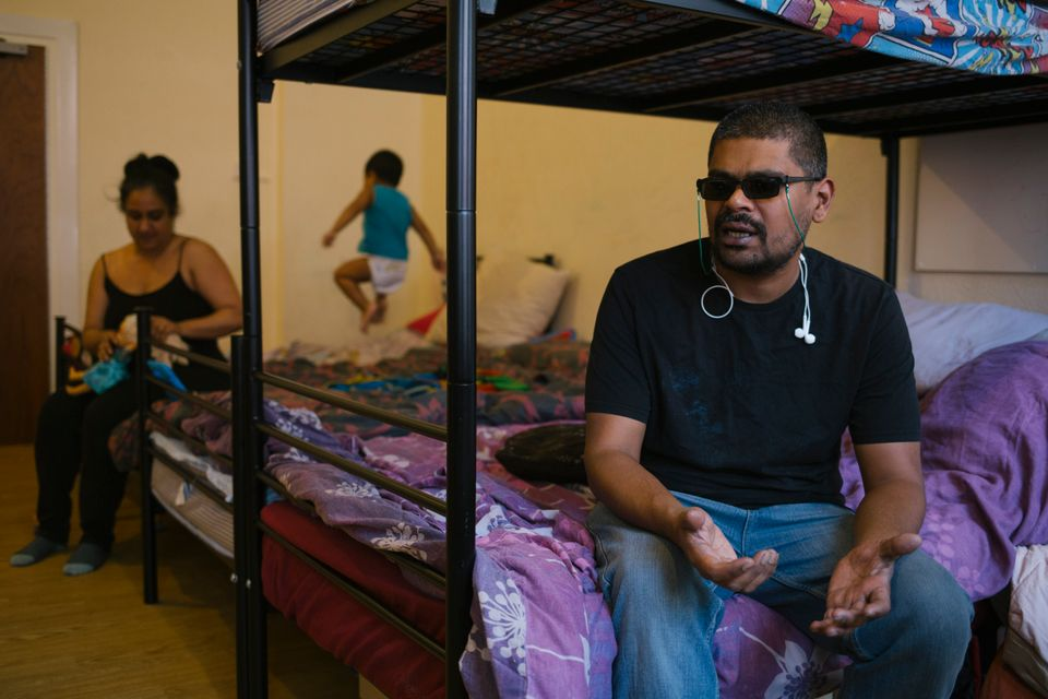 Mohammad and his family - and his guide dog - share a one-bed unit in a homeless
