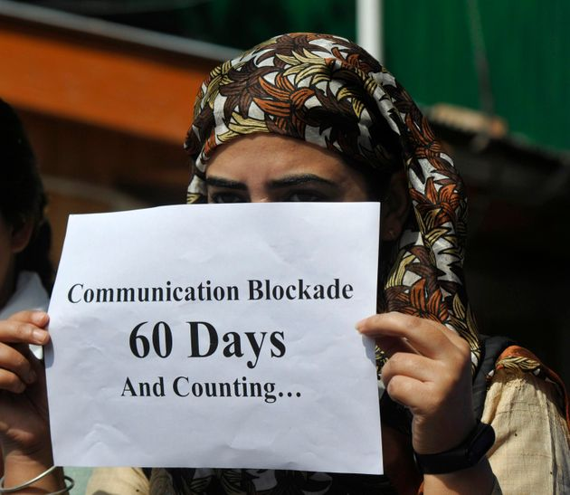 A Kashmiri journalist holding a poster to protest against the communication blockade on October 3, 2019...
