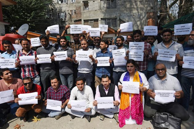 Kashmiri journalists holding posters to protest against the communication blockade on October 3, 2019...