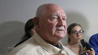 U.S. Secretary of Agriculture Sonny Perdue addresses questions from members of the media following a town hall meeting at the World Dairy Expo in Madison, Wis. Tuesday, Oct. 1, 2019. (John Hart/Wisconsin State Journal via AP)