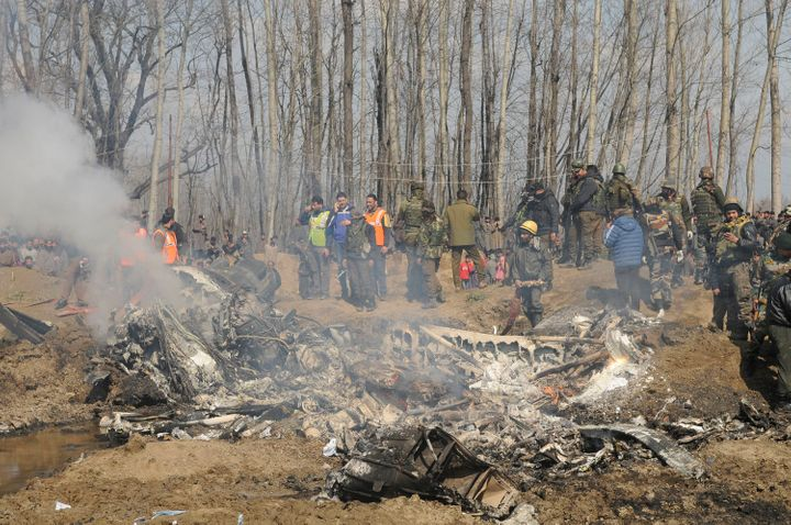 Paramilitary personnel stand near the wreckage of an Indian Air Force helicopter after it crashed on February 27, 2019 in Budgam, India.