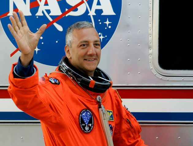 Mission specialist Michael Massimino at Kennedy Space Center in Cape Canaveral, Fla., Monday, May 11,...