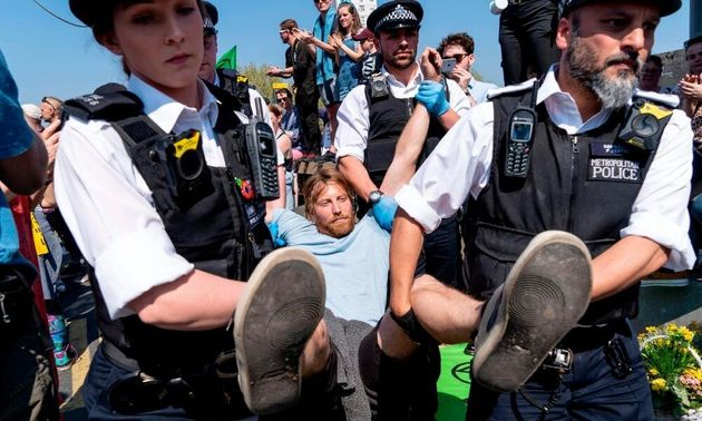Police make an arrest while clearing Waterloo Bridge of protesters earlier this