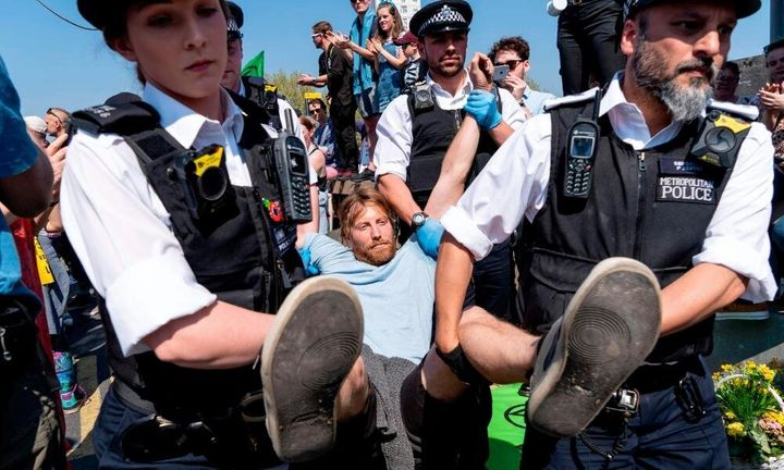 Police make an arrest while clearing Waterloo Bridge of protesters earlier this year.