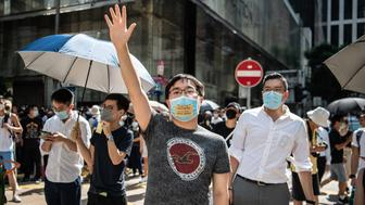 HONG KONG, CHINA - OCTOBER 4: People protest a government ban on face masks in Central on October 4, 2019 in Hong Kong, China. Hong Kong's government invoked emergency powers on Friday to introduce an anti-mask law which bans people from wearing masks at public assemblies as the city remains on edge with the anti-government movement entering its fourth month. Pro-democracy protesters marked the 70th anniversary of the founding of the People's Republic of China in Hong Kong as one student protester was shot in the chest in the Tsuen Wan district during with mass demonstrations across Hong Kong. Protesters in Hong Kong continue to call for Chief Executive Carrie Lam to meet their remaining demands since the controversial extradition bill was withdrawn, which includes an independent inquiry into police brutality, the retraction of the word riot to describe the rallies, and genuine universal suffrage, as the territory faces a leadership crisis. (Photo by Laurel Chor/Getty Images)