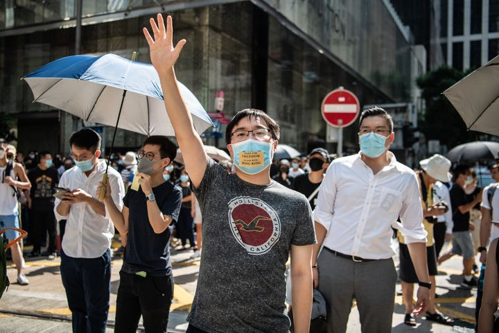 People protest a government ban on face masks in Central on October 4, 2019 in Hong Kong. (Photo by Laurel Chor/Getty Images)