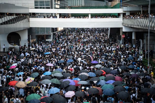 People protest a government ban on face masks in Central on October 4, 2019 in Hong Kong. (Photo by Laurel...