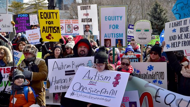 Hundreds of parents, therapists and union members gather outside Queen's Park in Toronto on March 7,...