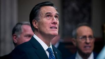 Sen. Mitt Romney, R-Utah, waits to participate in a mock swearing in ceremony in the Old Senate Chamber on Capitol Hill in Washington, Thursday, Jan. 3, 2019, as the 116th Congress begins. (AP Photo/Andrew Harnik)