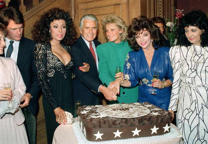 "Cast members of ""Dynasty"" cut a cake to commemorate the production of 150 episodes of the television series in Los Angeles, C"