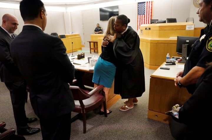 Amber Guyger gives Judge Tammy Kemp a hug at the Frank Crowley Courts Building in Dallas, Texas, U.S. October 2, 2019.