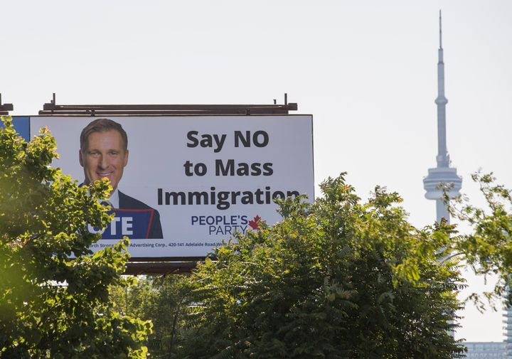 A Toronto billboard sign promoting the People's Party of Canada, which has promised to reduce the country's immigration numbers if elected. The sign were not funded by the party.