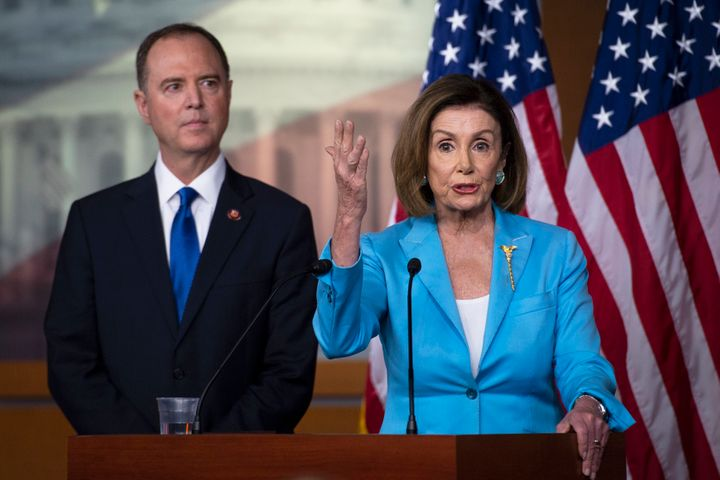 Speaker Pelosi, right, addressed reporters alongside Intelligence Committee Chairman Adam Schiff (D-Calif.). Her support for