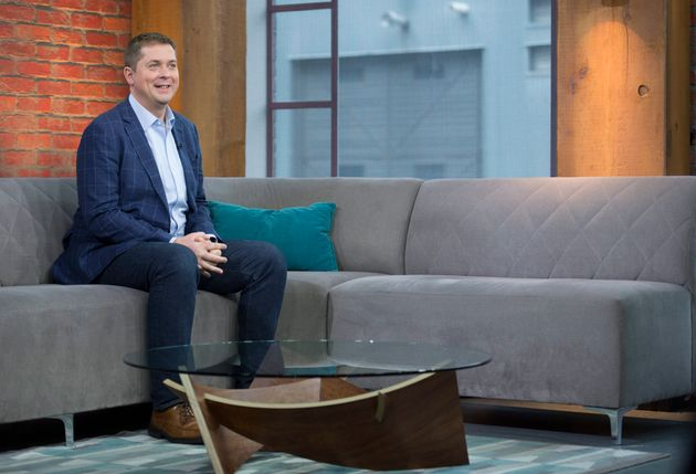 Conservative leader Andrew Scheer sits on a sofa as he waits for a interview on CP24 to begin in downtown...