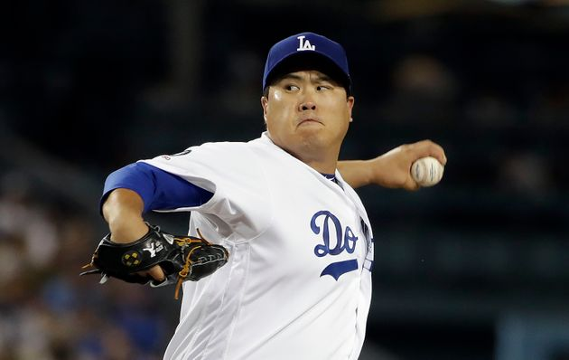 Los Angeles Dodgers starting pitcher Hyun-Jin Ryu throws to a Colorado Rockies batter during the second...