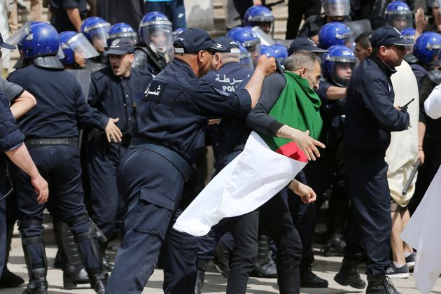 Clashes between riot police and Algerian demonstrators, Algiers, Algeria, May 17 For a radical change...
