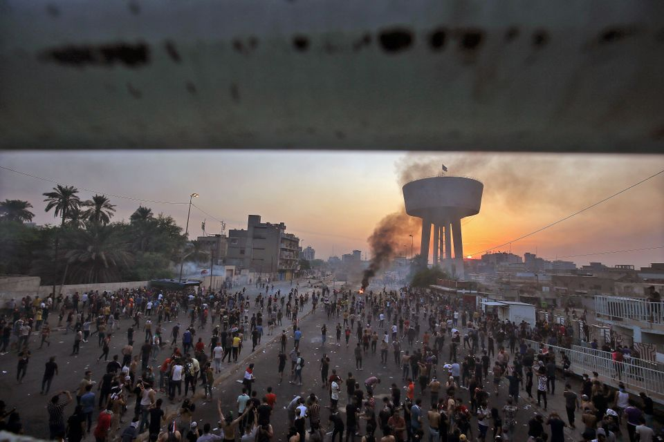 Iraqi protesters gather at Tayaran square in Baghdad on October