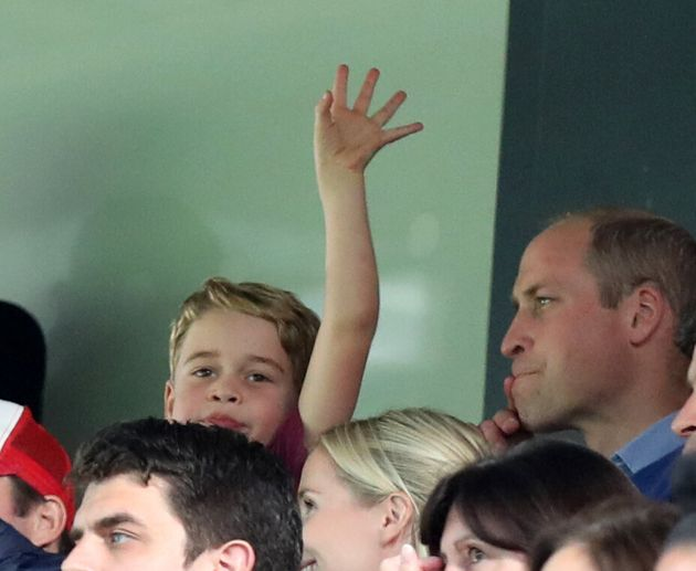 NORWICH, ENGLAND - OCTOBER 05: Prince George waving at Carrow Road as he watches with his father Prince...