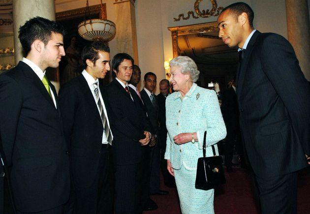 Queen Elizabeth II meets Arsenal football team members (L to R) Francesc Fabregas, Mathieu Flamini, Tomas...