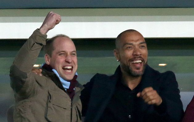 The Duke of Cambridge and John Carew celebrate Jack Grealish scoring his side's first goal of the game...