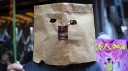 Defying Hong Kong Mask Ban, Tens Of Thousands Of Protesters Clog City's