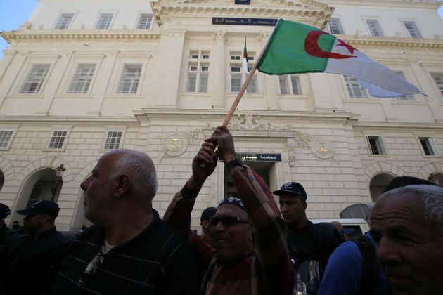 Algerians gather in front of Algiers Court of Justice during a protest against former Algerian Prime...
